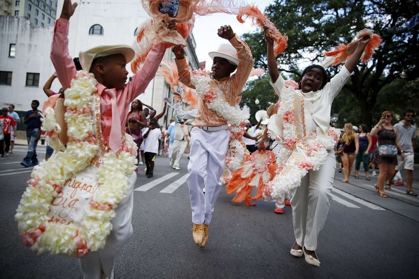 The Original Big 7 Junior Steppers parade through the Central Business District in a second line parade to mark the 10th anniversary of Hurricane Katrina in New Orleans, Louisiana on Aug 29, 2015.