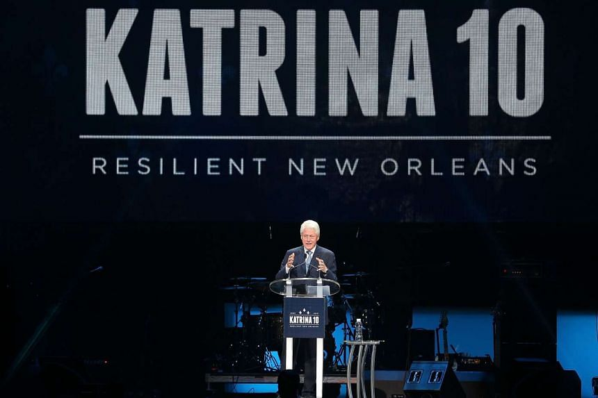 Former US President Bill Clinton speaks during a Hurricane Katrina 10th anniversary event at the Smoothie King Centre in New Orleans, Louisiana on Aug 29, 2015.