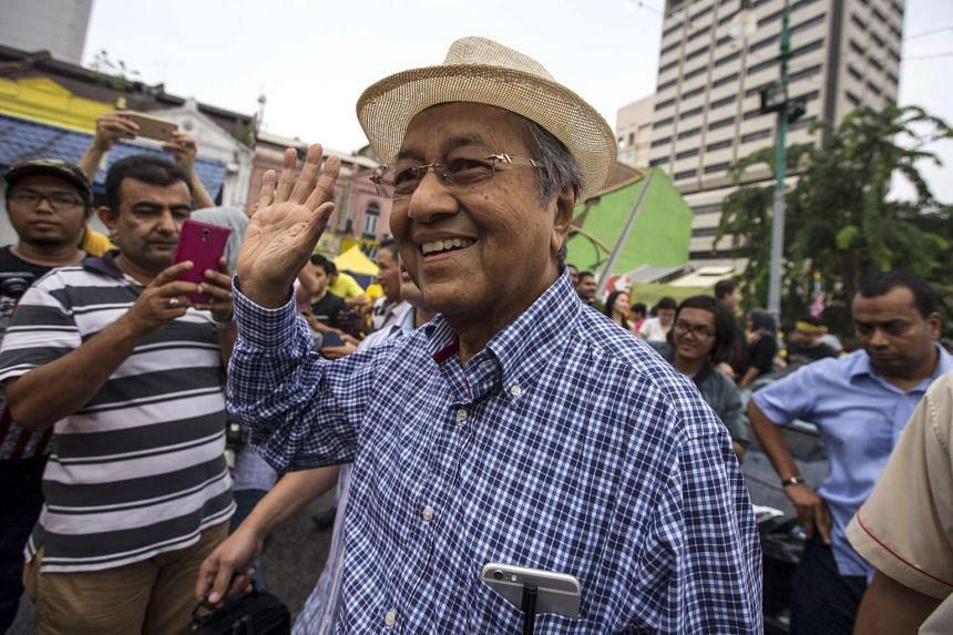 Former Malaysian prime minister Mahathir Mohamad (centre) waving as he attends a rally organised by pro-democracy group Bersih near Central Market in Kuala Lumpur on Aug 30, 2015.
