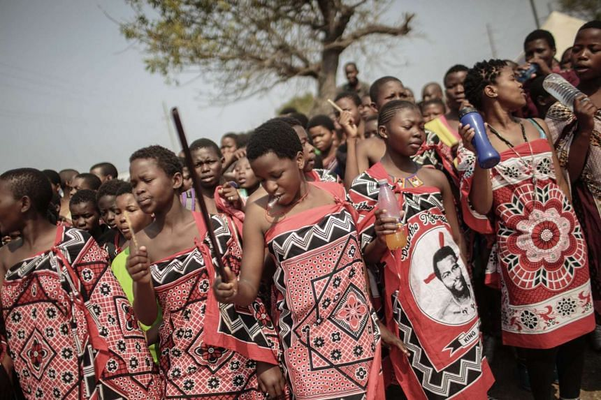 Swaziland girls dance and sing as they walk to the Royal palace two days ahead of the traditional reed dance on Aug 28, 2015.