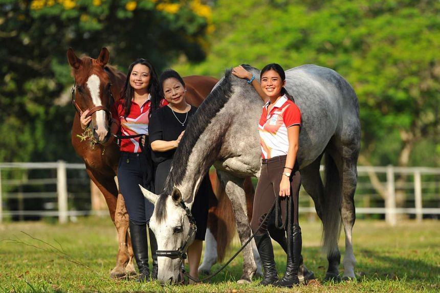 Dr Melanie Chew with her daughters, equestriennes Caroline (left) and Catherine.