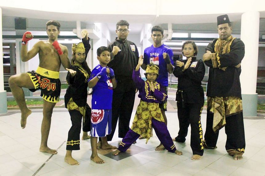 Silat world champion Sheik Alau'ddin (right) with his wife Saadiah Sanuse and their six children, (from right) Farhan, Ashiddiq, Fayz, Nur Shafiqa, Ferdous and Nur Shaqira (the youngest), who are all silat enthusiasts.