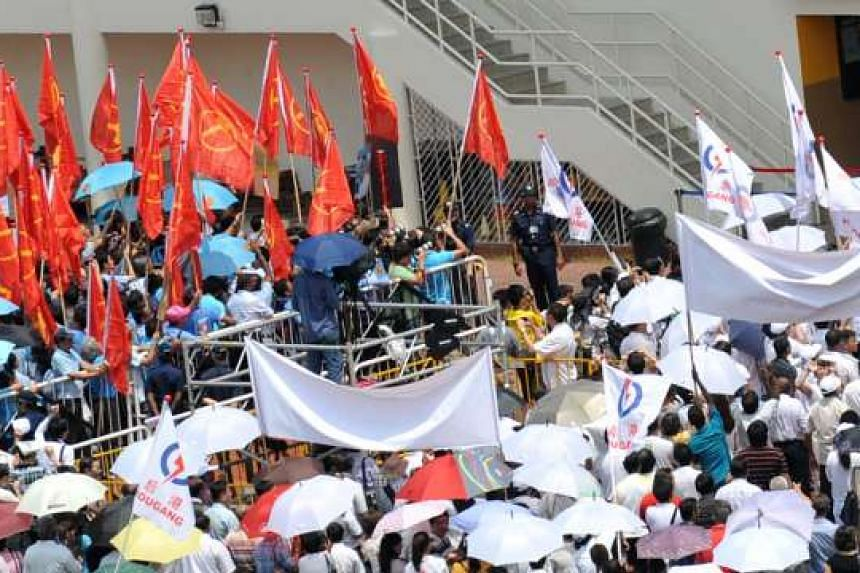 Supporters of the Workers' Party (left) and People's Action Party at Serangoon Junior College on Nomination Day for the Hougang by-election in May 2012. WP has set a long-term goal of 20 opposition members in Parliament.