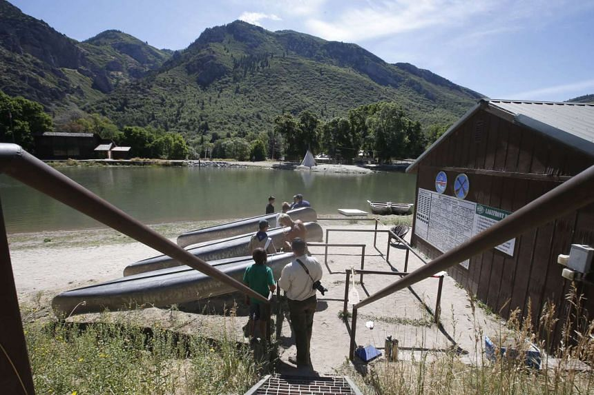 Boy Scouts working on canoes at camp Maple Dell on Aug 31, 2015, outside Payson, Utah.