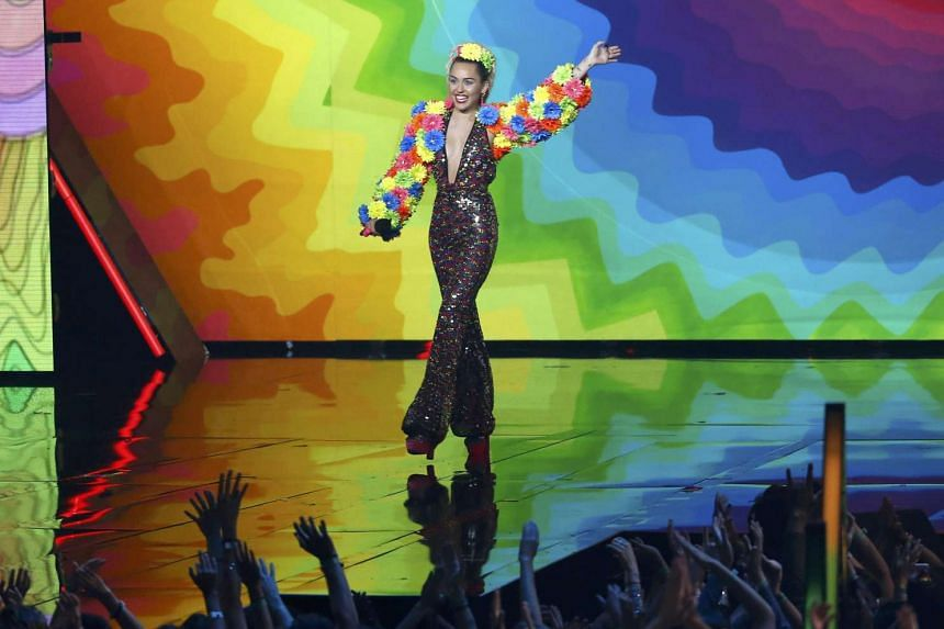 Show host Miley Cyrus takes the stage at the 2015 MTV Video Music Awards in Los Angeles, California, on Aug 30, 2015.