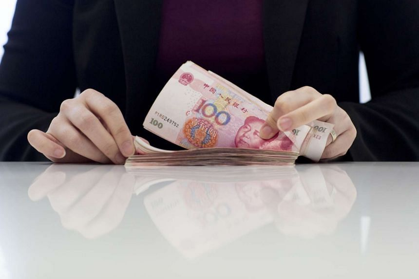 China's yuan firmed after the central bank set a stronger guidance rate while it also appeared to continue using state-owned banks to support the Chinese currency.