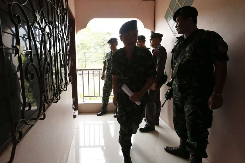 Thai soldiers and police officers examine a rented room which is believed to be linked with the arrested foreign suspect during a joint force military and police searching operation at Mimuna Garden Home apartment in Minburi district, Thailand on Aug
