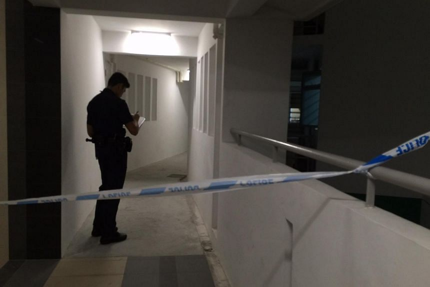 The area outside the 15th floor unit of Block 636B was cordoned off.