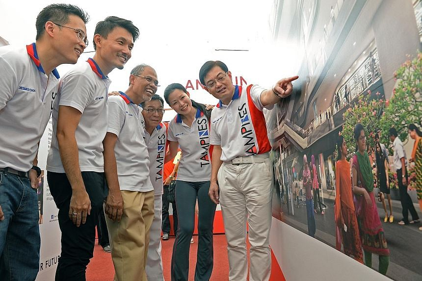(From left) Mr Desmond Choo, Mr Baey Yam Keng, Minister in the Prime Minister's Office and Tampines grassroots adviser Masagos Zulkifli, Mr Mah Bow Tan, Ms Cheng Li Hui and Education Minister Heng Swee Keat at the Our Tampines Hub exhibition yesterda