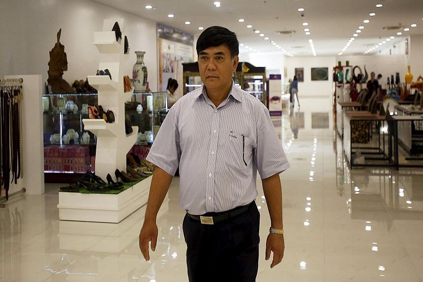 Mr Nguyen Huu Duong in a store in his building in Hanoi, Vietnam, last Saturday. He said he spent $38 million on the V+ mall, which opened in February. It reduces overheads to slash prices.