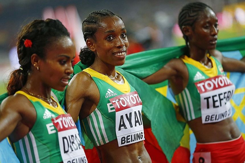 From far left: Third-placed Genzebe Dibaba poses with her compatriots - winner Almaz Ayana and second-placed Senbere Teferi - after the Ethiopian trio shut out all other rivals in the 5,000m final.
