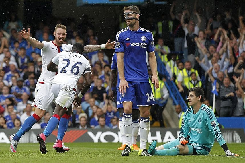 Crystal Palace midfielder Bakary Sako (second from left) celebrates after scoring his team's first goal against Chelsea. The Blues are now eight points behind Manchester City.
