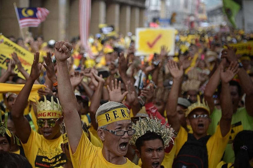 (Clockwise, from above) Protesters from the Orang Asli community marching at the Bersih 4.0 rally yesterday; participants sleeping on the street overnight in Kuala Lumpur; and former prime minister Mahathir Mohamad making an appearance at the rally n