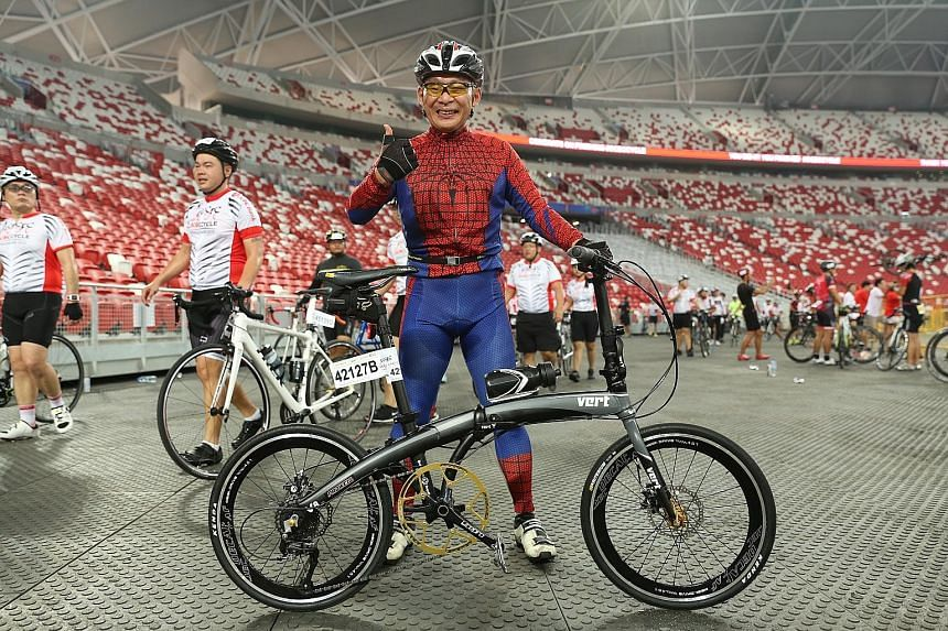 While quite a few participants at yesterday's OCBC Cycle boasted fancy bikes, Mr Stanley Neo, aka 'Spider-Man', stood out by riding in a fancy costume in The Straits Times Ride (23km). The 51-year-old was among more than 7,300 cyclists who took part