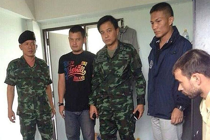 The Turkish suspect (sitting at far right) with bomb-making materials after his arrest at an apartment in the outskirts of Bangkok last Saturday. The items found in the flat included pipes and fuses, and ball bearings of the type used in the Aug 17 b