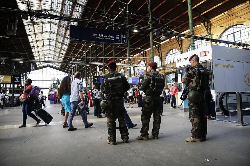 """Three French soldiers patrolling the Gare du Nord train station in Paris last Friday. French Interior Minister Bernard Cazeneuve said multinational patrols already existed in major stations, but that ministers had agreed to increase their """"efficiency"""