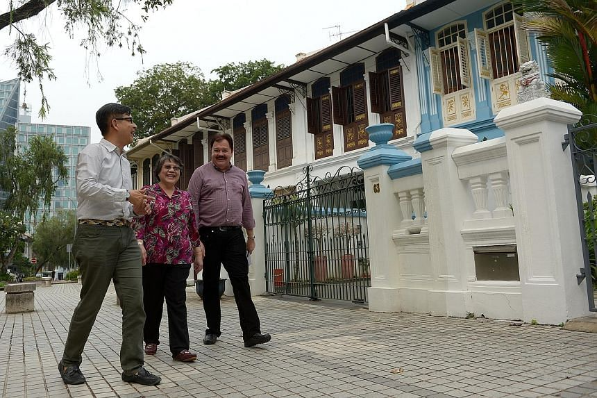 URA director of conservation management Kelvin Ang (above) with home owners June Chia and Richard Helfer, who is also vice-president of the Emerald Hill Conservation Association. While both are in favour of maintaining a pastel palette for the herita