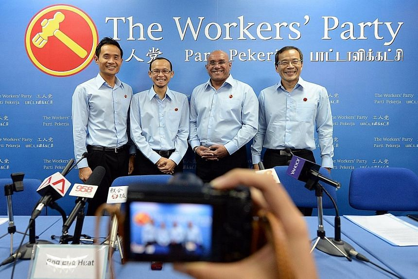 Lawyer Gurmit Singh (third from left) appeared at a SingFirst event after he quit the Workers' Party, but then retracted his resignation. He was introduced as a WP candidate yesterday, along with (from left) Mr Kenneth Foo, a manager at a voluntary w