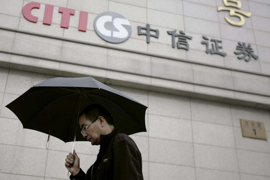 A man walking past a branch of Citic Securities in Beijing.