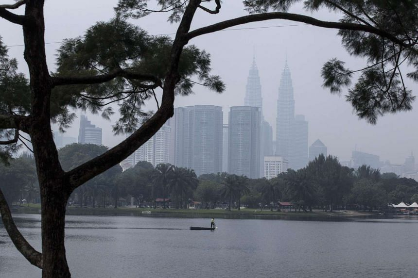 Malaysia's Petronas Twin Towers and surrounding buildings are seen shrouded by thick haze in Kuala Lumpur, Malaysia on Aug 25, 2015.