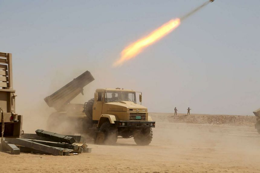 Iraqi security forces launch a rocket towards Islamic State in Iraq and Syria militant positions on the outskirts of Anbar province, Iraq, on Aug 22, 2015