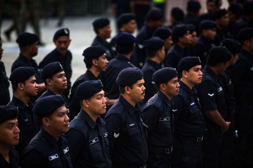 Members of the Malaysia's riot police stand guard during the Coalition for Clean and Fair Elections rally, also known as Bersih, in Kuala Lumpur, Malaysia, on Saturday, Aug. 29, 2015.