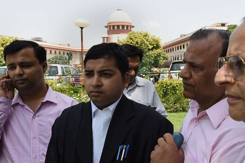 """Rajesh Jain, (centre), one of the lawyers representing the Jain community, talks to the media after the Supreme court judgement on """"Santhara"""" in New Delhi on Aug 31, 2015."""