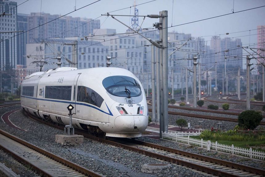 A Tianjin bound China Railways CRH3 high speed train departs the Beijing South station in Beijing, China, on Monday, Aug. 22, 2011