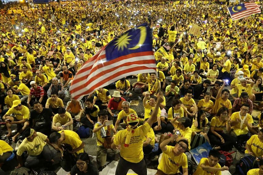 A Malaysian protester waves flag during the Bersih  rally in Kuala Lumpur, Malaysia on Aug 30, 2015.