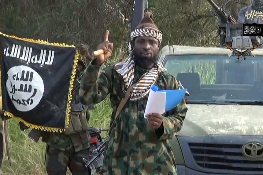 A file picture of a screengrab taken on October 2, 2014 from a video released by the Nigerian Islamist group Boko Haram shows Boko Haram leader, Abubakar Shekau gesturing as he delivers a speech.