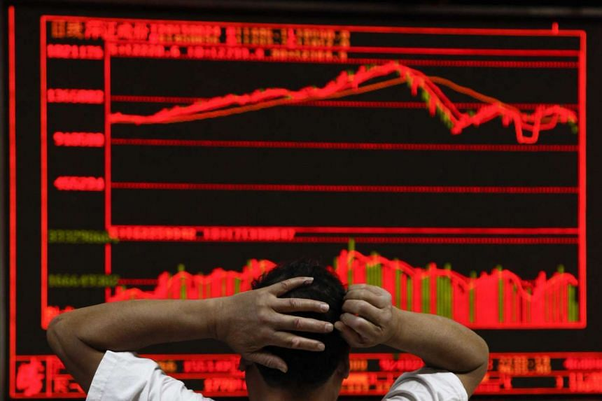 An investor monitors stock data on an electronic board at a securities brokerage house in Beijing on Aug 24.
