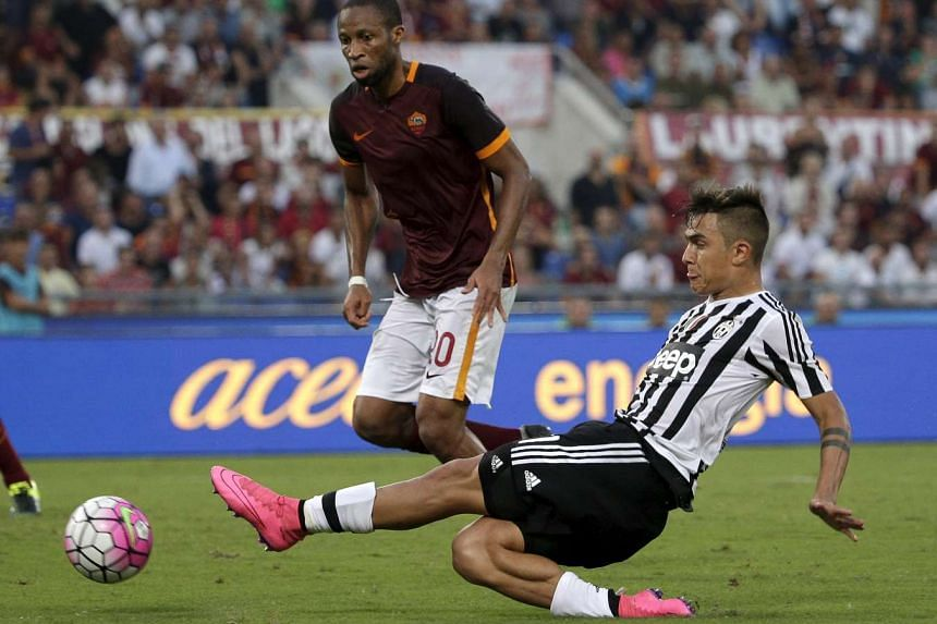 Juventus Dybala kicks the ball during the match against AS Roma in their Serie A soccer match at Olympic stadium in Rome.
