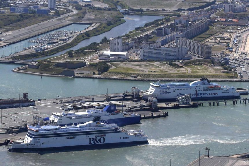 An aerial view shows a P&O ferry (front) and a MyFerryLink car and passenger ferry (back) in the harbour of Calais, northern France.