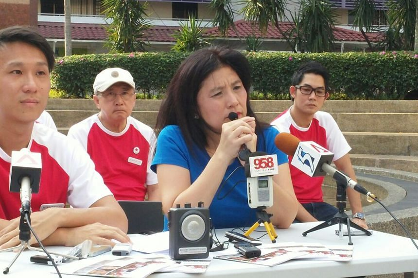 Singapore People's Party candidate Jeanette Chong-Aruldoss (right) speaking during the launch of the party's manifesto for Mountbatten, at Kampong Arang, on Aug 31, 2015. Sitting with her is her campaign manager Remy Choo.