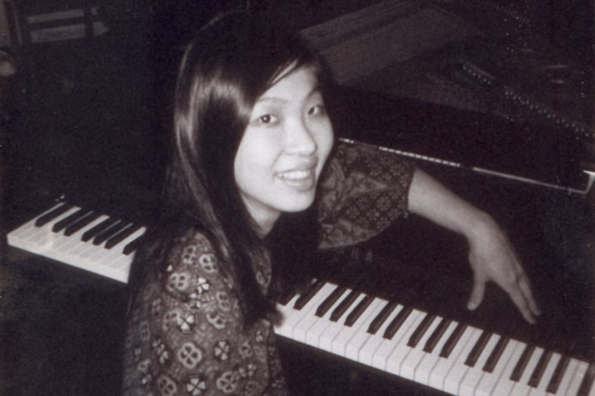 Tan (above) practising on the piano at Juilliard in 1967.