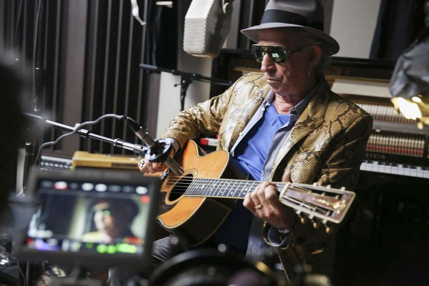 Rolling Stones guitarist Keith Richards goes back to the recording studio and emerges with an album where the instruments are hand-played and the vocals are scratchy growls.