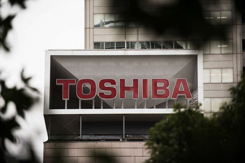 The Toshiba Corp. logo is displayed on a liquid crystal display (LCD) television in Kawasaki, Kanagawa Prefecture, Japan, on Monday, August 31, 2015. Toshiba gained the most in more than four years in Tokyo trading after appointing Masashi Muromachi