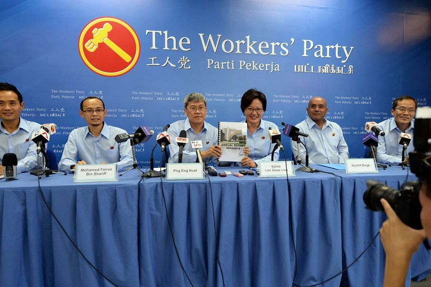The WP's Ms Sylvia Lim (4th from left) and Mr Png Eng Hua (3rd from left) holding a copy of their annual report 2014/2015 during the introduction for new candidates for the coming General Election.