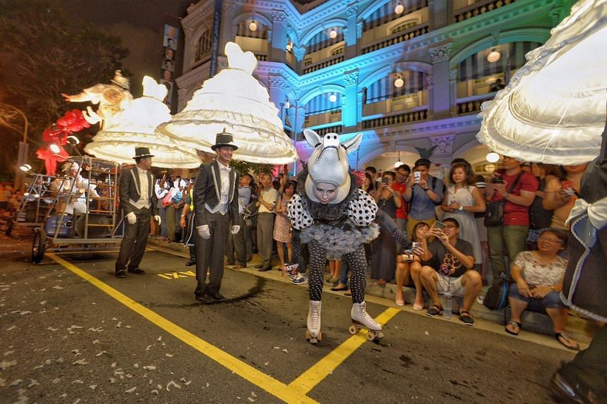 Photographs of Garden of Angels parade at Armenian Street and aerial performance at National Museum on Highlights of Singapore Night Festival.