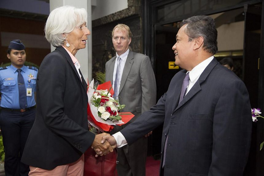 International Monetary Fund Managing Director Christine Lagarde (left) being greeted by Bank of Indonesia Deputy Governor Perry Warjiyo at the Jakarta International Airport in Jakarta, Indonesia on Aug 31, 2015.