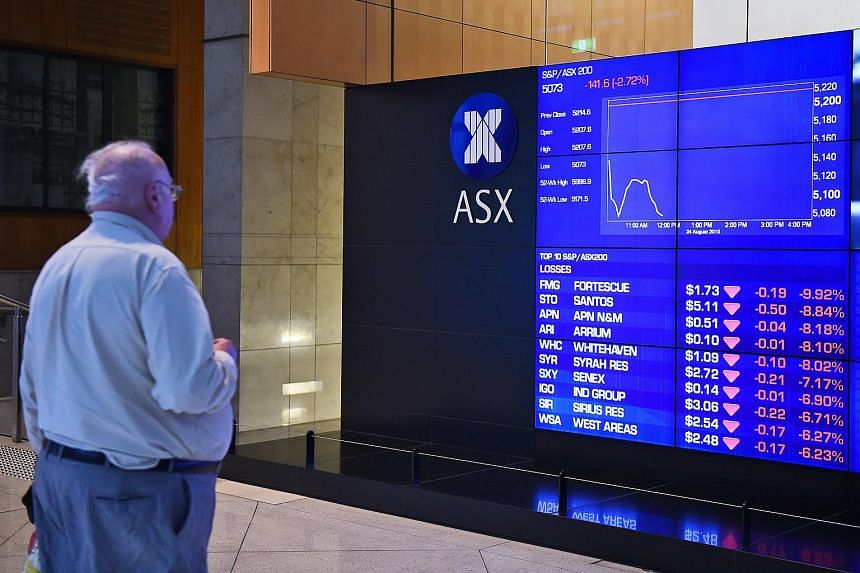 A man stops to look at the electronic share board at the Australian Stock Exchange (ASX) in Sydney, Australia on Aug 24, 2015.