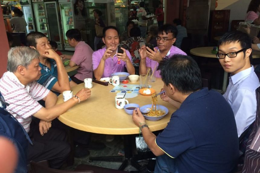 PPP Chua Chu Kang GRC team members Lee Tze Shih and Syafarin having breakfast at a shopping centre in the constituency before heading to the nomination centre.