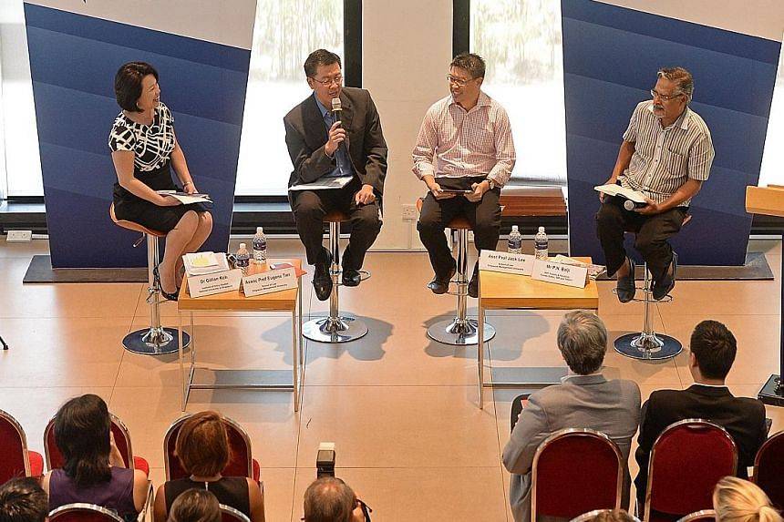 The panel at yesterday's forum comprised (from left) Dr Gillian Koh, associate professor Eugene Tan, assistant professor Jack Lee and communications consultant P.N. Balji.