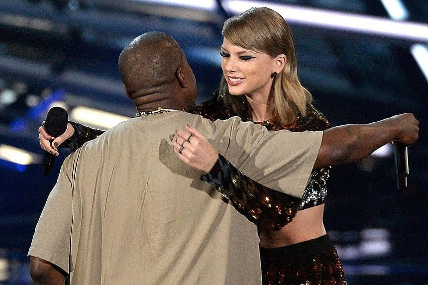 MTV Video Music Awards host Miley Cyrus shocked her way through her hosting duties with her outfits, many of them scanty (top and above). Kanye West receiving the Michael Jackson Video Vanguard Award from Taylor Swift (both left) in a full circle mom