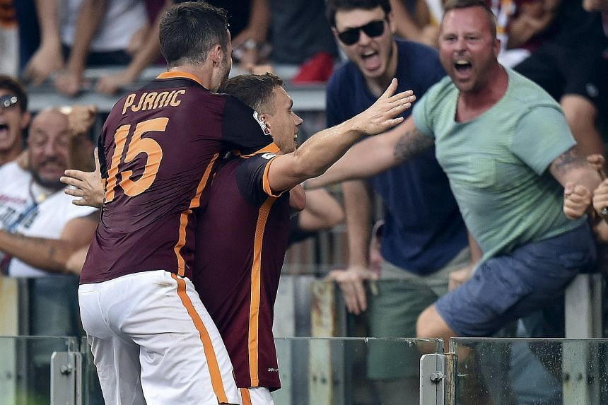 Roma striker Edin Dzeko (right) and team-mate Miralem Pjanic were on target to send a woeful Juventus to two defeats in as many games of the new Serie A season.