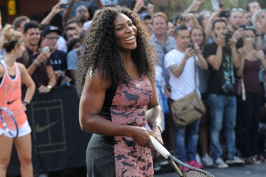 Serena Williams at a New York City street tennis event on Aug 24. She is on the verge of becoming only the fourth woman to complete a calendar-year Grand Slam.