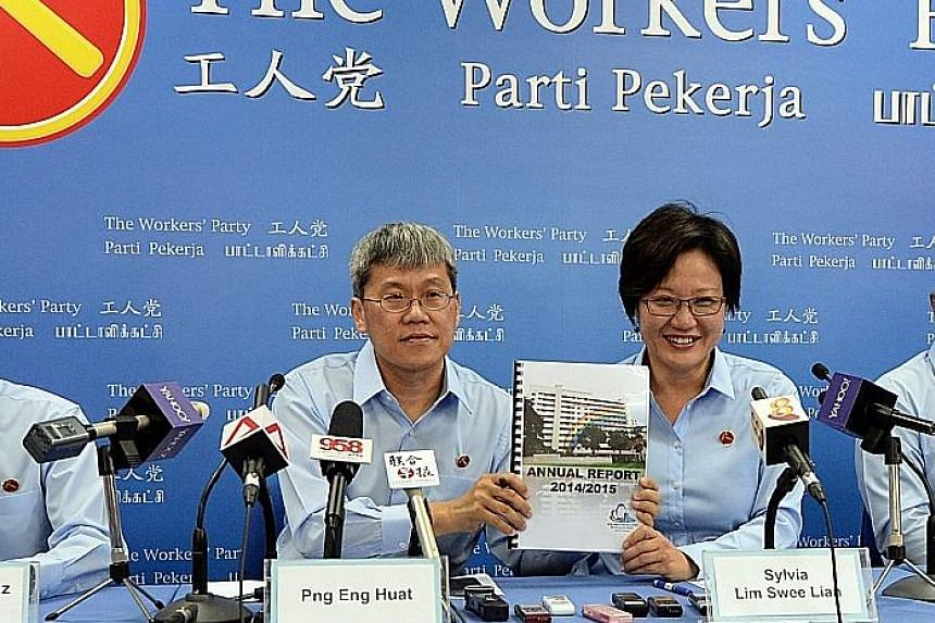 Hougang MP Png Eng Huat and Workers' Party chairman Sylvia Lim holding a copy of Aljunied-Hougang-Punggol East Town Council's latest annual report for financial year 2014/2015 during the introduction of the party's candidates for the general election