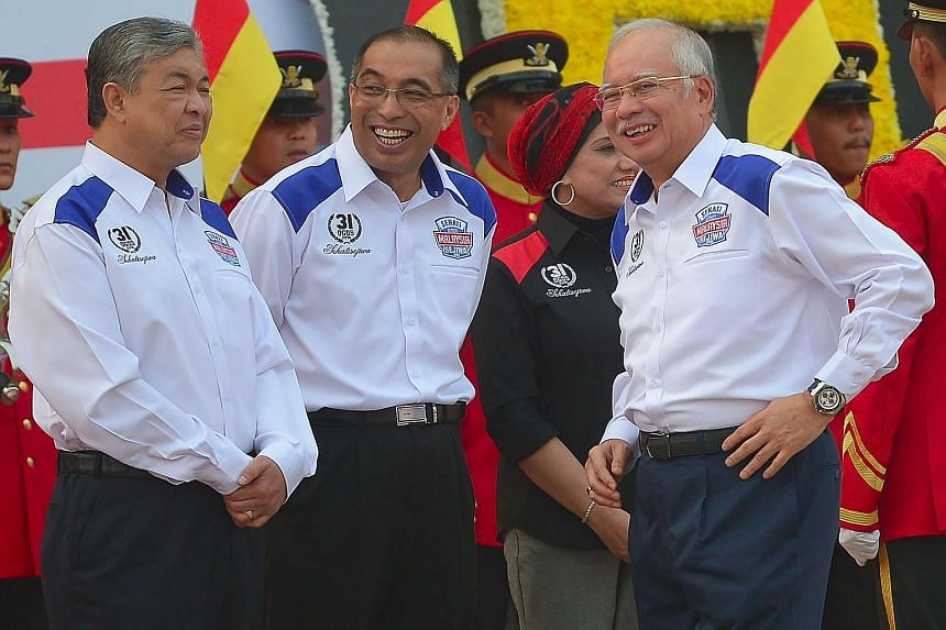 Prime Minister Najib Razak (right), with his deputy Ahmad Zahid Hamidi (left) and Communications and Multimedia Minister Salleh Said Keruak, at Dataran Merdeka in Kuala Lumpur before the start of Independence Day celebrations yesterday. Malaysia's 58