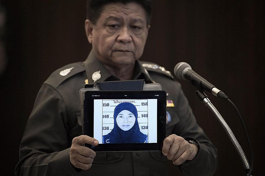Thailand's national police spokesman Prawut Thavornsiri (left) displaying a picture of suspect Wanna Suansant yesterday, after bomb-related materials were found in a flat she had rented. (Above) A police arrest warrant handout of a sketch of an unide