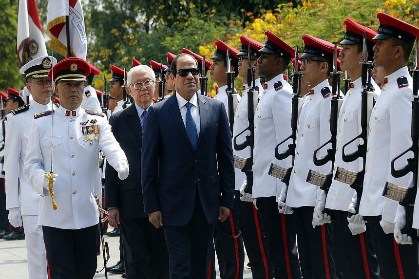 Egyptian President Abdel Fattah al-Sisi, with Singapore President Tony Tan Keng Yam, inspecting the guard of honour during a welcome ceremony at the Istana yesterday. Mr Sisi is on his first state visit here.